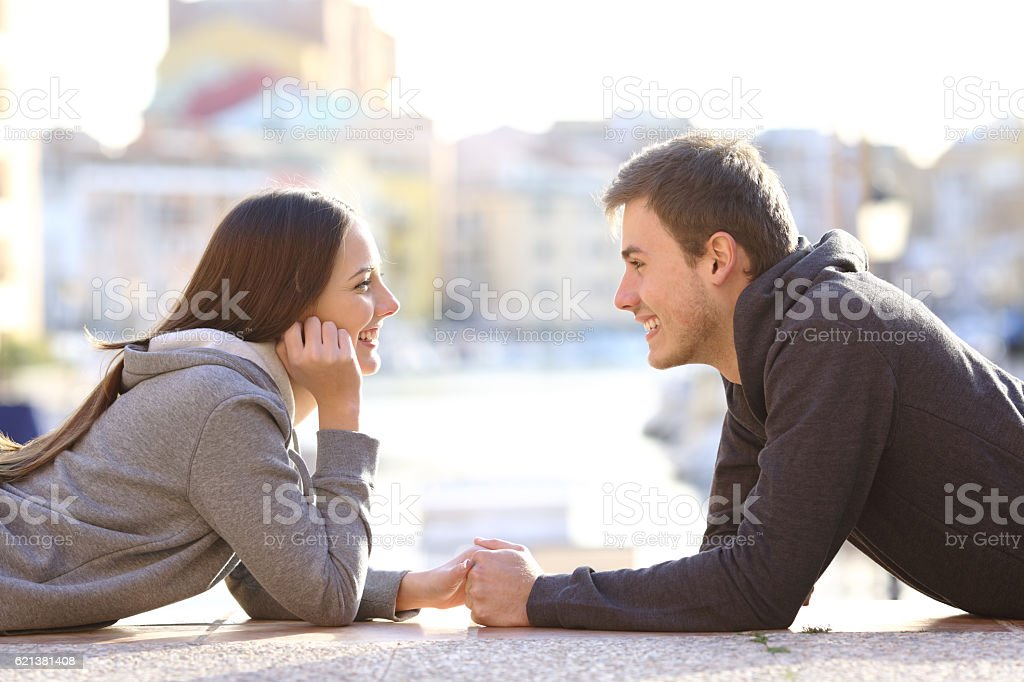 Couple of teenagers in love  looking each other stock photo