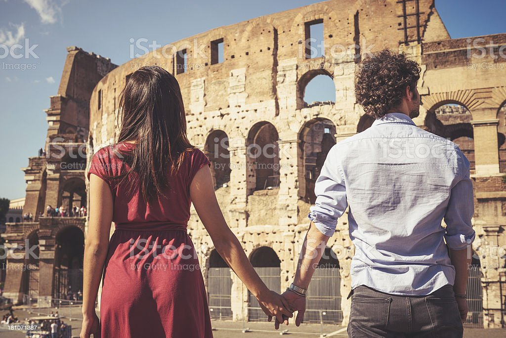 couple of tourist in front at coliseum royalty-free stock photo