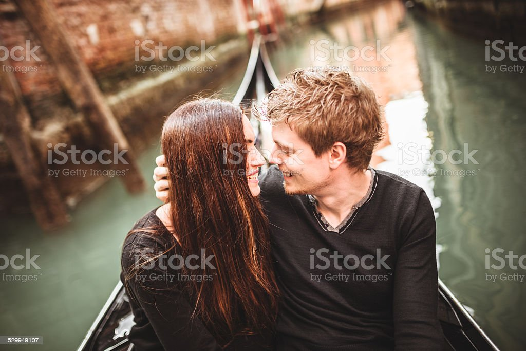 couple of tourist on the gondola in venice stock photo