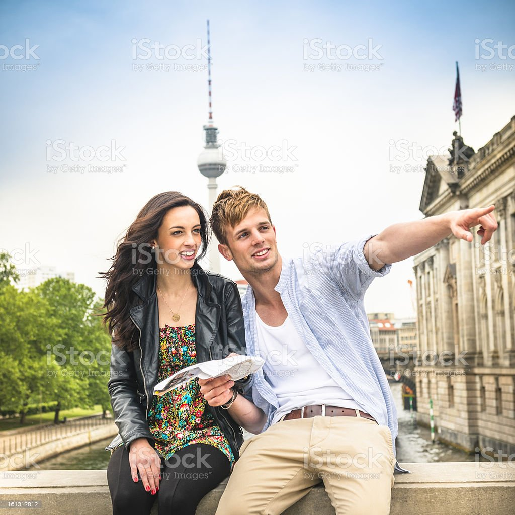 Couple of tourist reading a map in berlin royalty-free stock photo