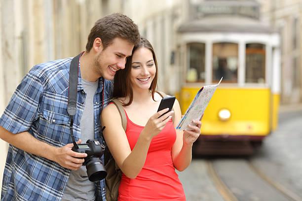 couple of tourists consulting guide online - portugal map imagens e fotografias de stock