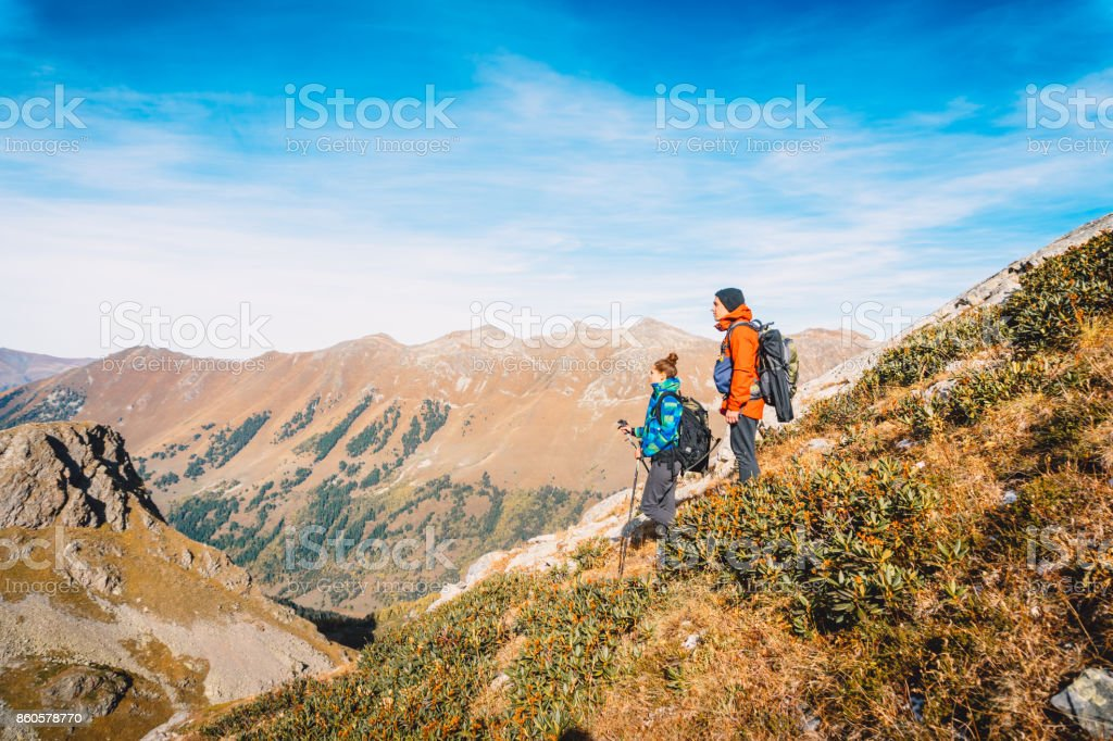 Couple of tourists in the mountains. stock photo