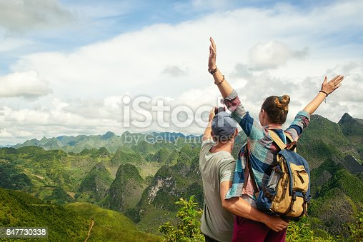 istock couple of tourists making selfie on background of karst mountains. 847730338