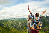 Couple of tourists making selfie on the background of beautiful karst mountains, North Vietnam.