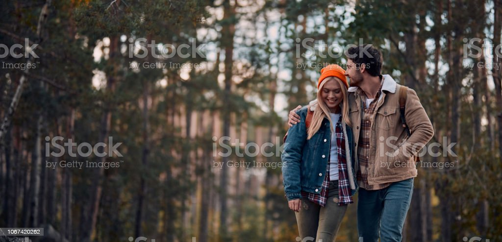 Couple of tourists on nature royalty-free stock photo