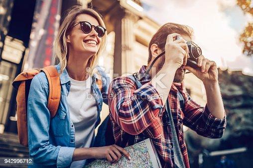 istock Couple of tourists 942996712