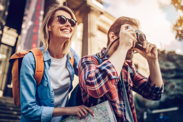 couple of tourists - travel stock pictures, royalty-free photos & images
