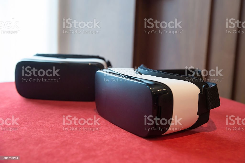 Couple of virtual reality headsets stock photo