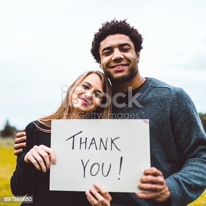 istock couple of volunteer with paper say thanks 697986680