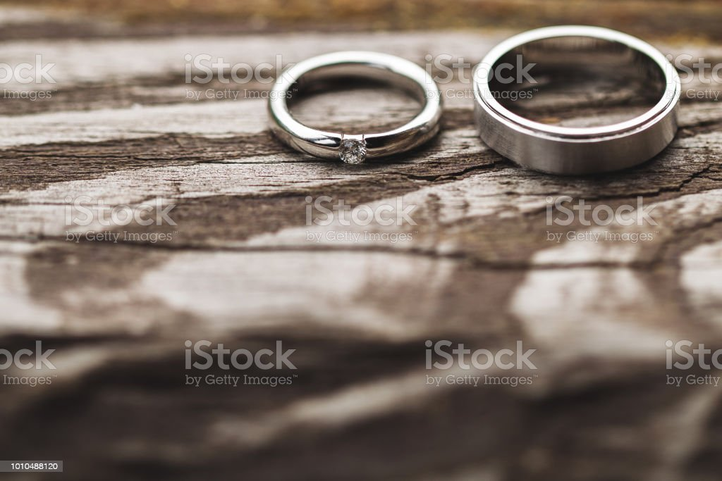 Couple Of Wedding Rings With Diamond Close Up On Shabby Wooden Texture Stock Photo Download Image Now Istock