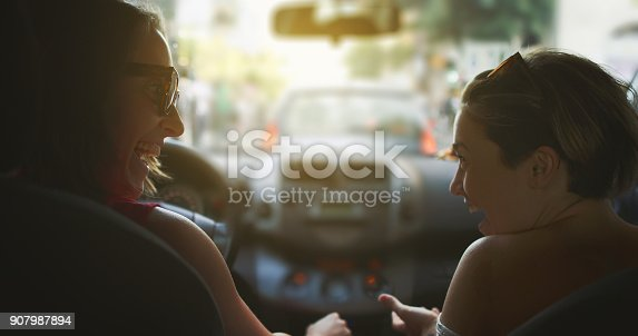 907987862 istock photo Couple of women in the traffic of Rome 907987894