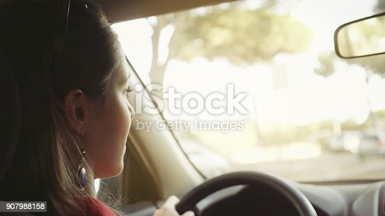 907987862 istock photo Couple of women in the traffic of Rome 907988158