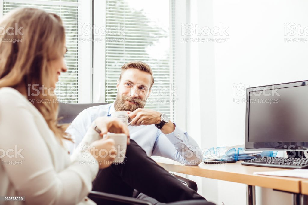 Couple of young colleagues drinking coffe - Royalty-free Adult Stock Photo