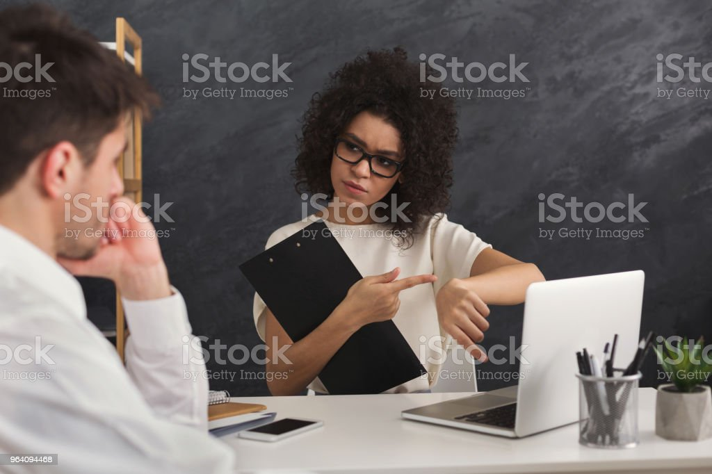 Couple of young colleagues work at modern office - Royalty-free Adult Stock Photo