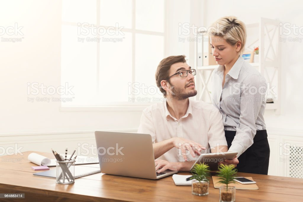 Couple of young colleagues work at modern office royalty-free stock photo