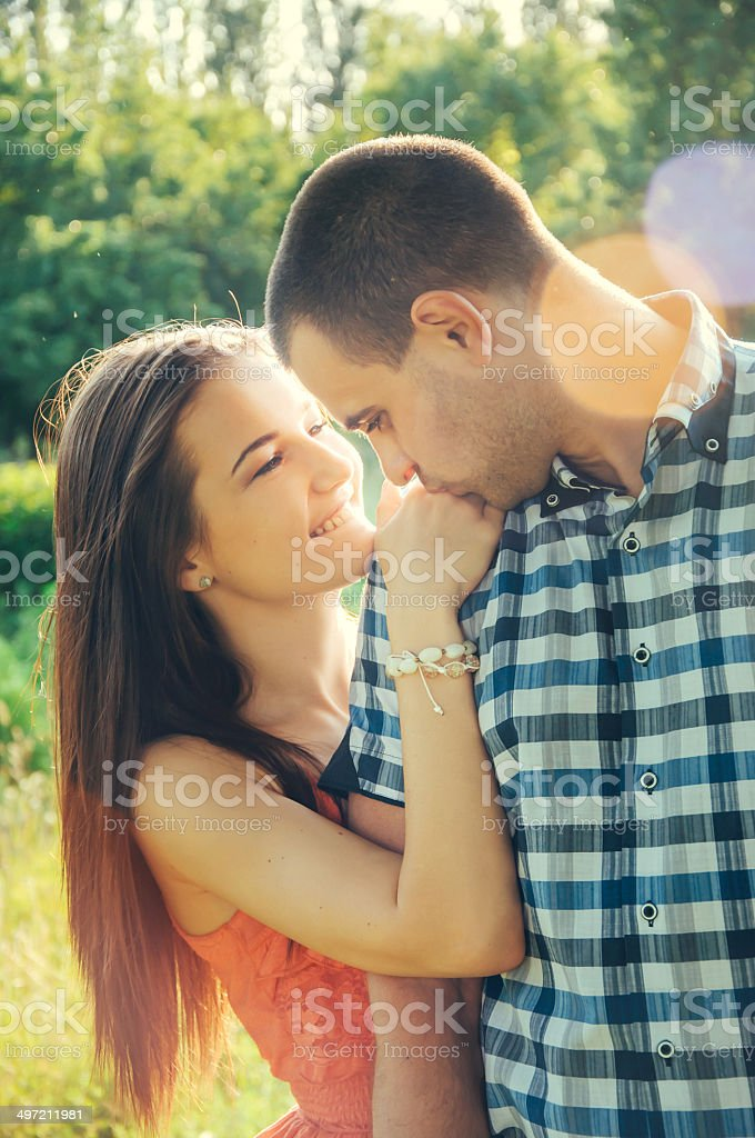 Couple of young lovers hugging stock photo