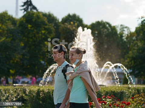 istock Couple of young man and woman in the public park in summer day 1269377694