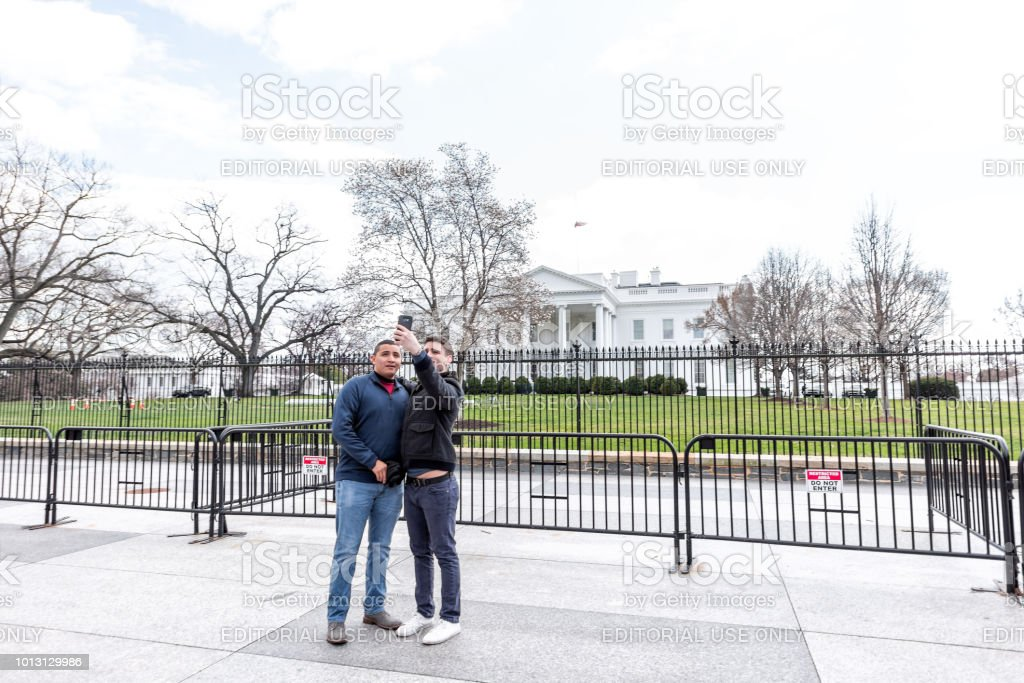 Couple of young men people in front of White House President building...