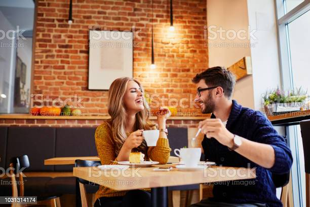 Couple of young people drinking coffee and eating cake in a stylish picture id1031314174?b=1&k=6&m=1031314174&s=612x612&h=uqrgbxdop0aliazveglxw jgbwhnq4em0miqwdagsde=