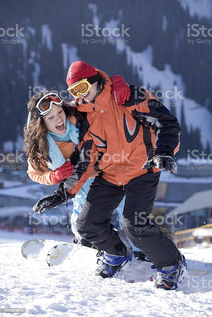 Couple of young snowboarders stock photo