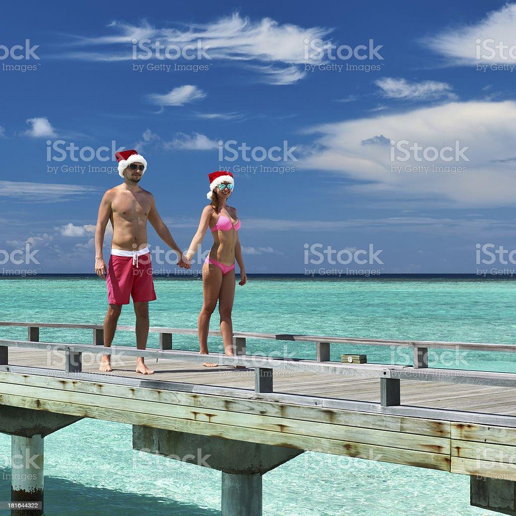Couple on a beach jetty at Maldives royalty-free stock photo