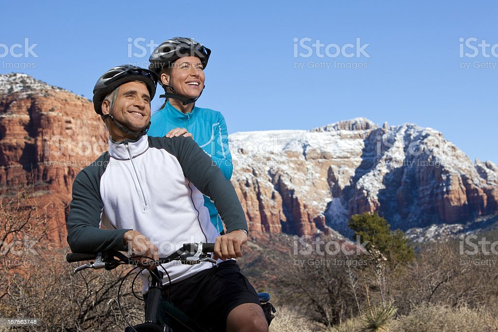 Couple on a bike ride royalty-free stock photo