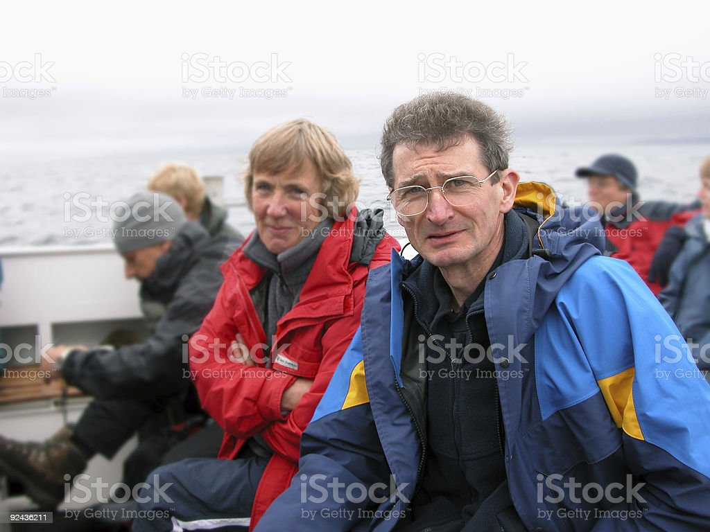 couple on a boat stock photo
