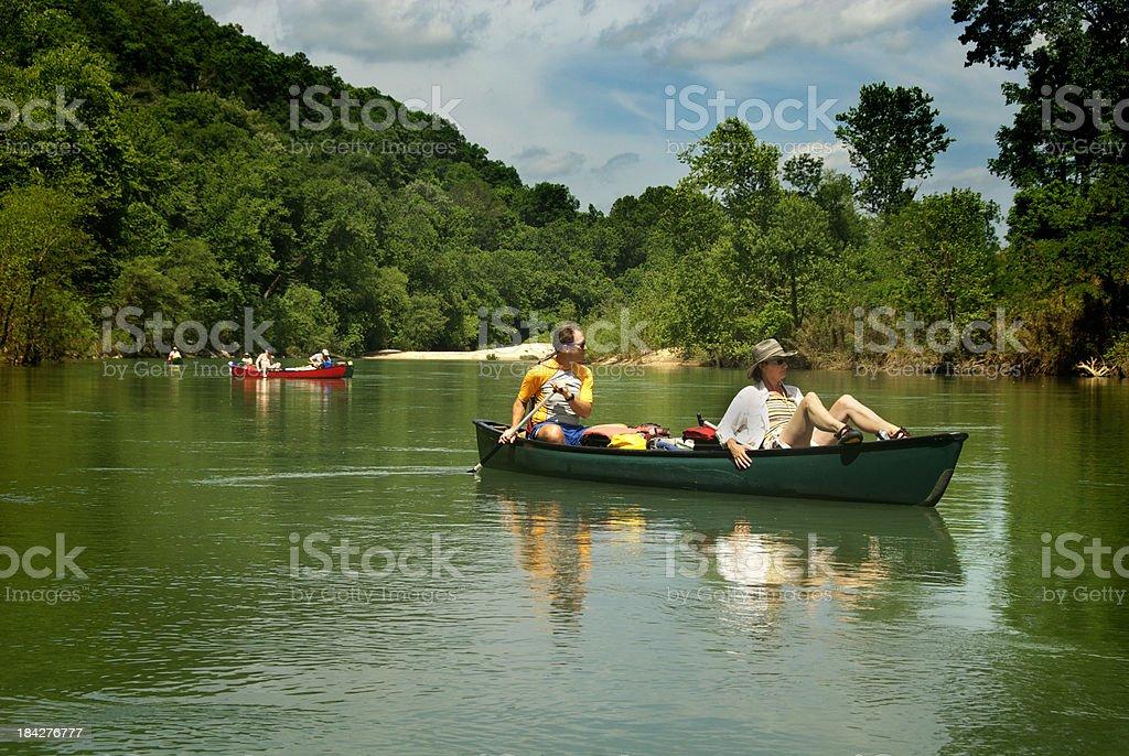 Couple on a Canoe Trip royalty-free stock photo