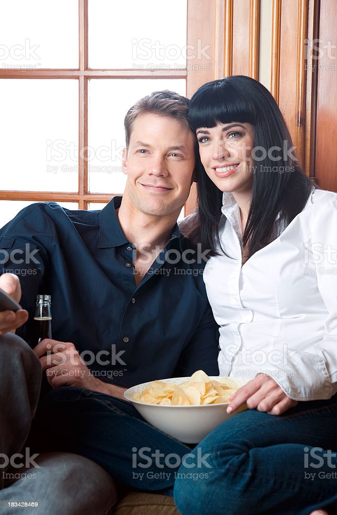 Couple on a Couch Watching Television royalty-free stock photo