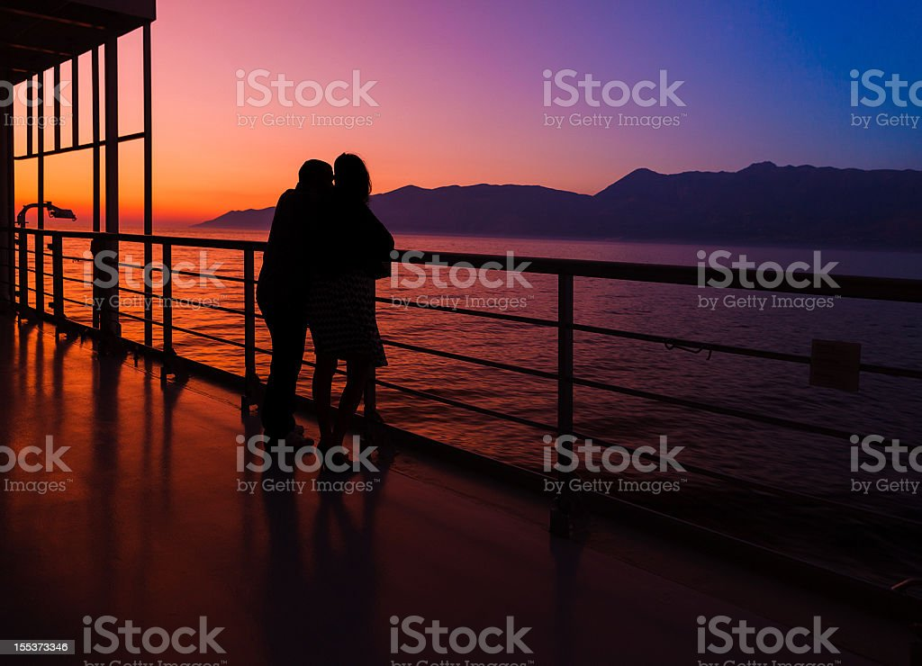 couple on a cruise ship at sunset royalty-free stock photo