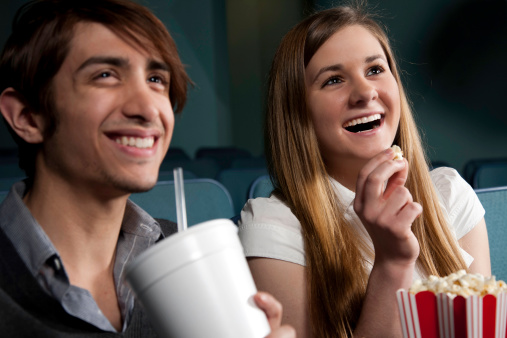 istock Couple on a Date at the Movies Having Fun Together 182492790