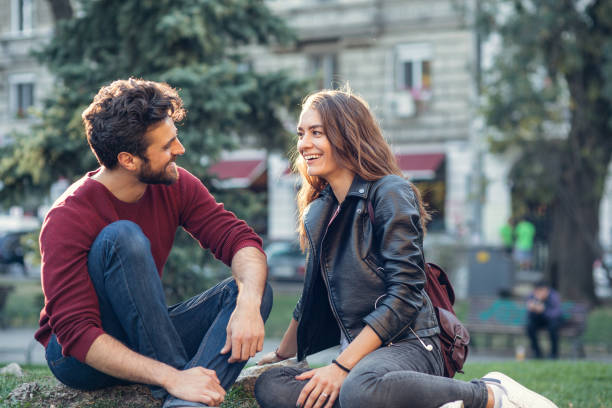 couple on a date at the park - dating stock photos and pictures