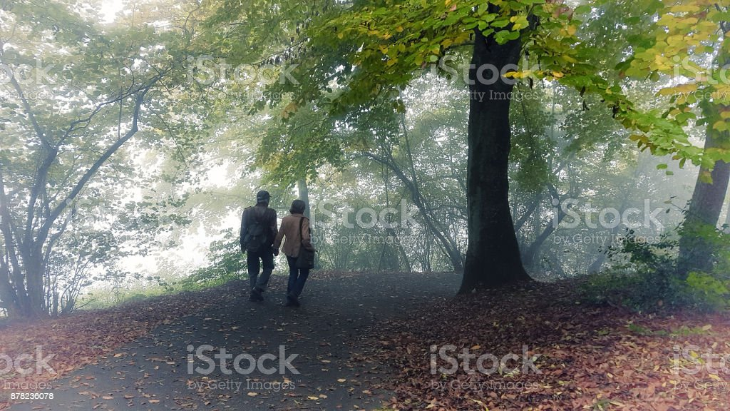 A couple on  a footpath stock photo