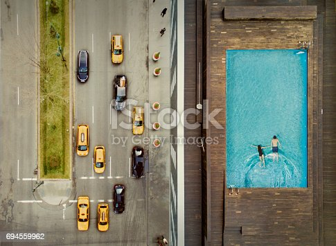 istock Couple on a New York City rooftop. Image composition. 694559962