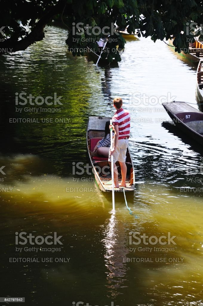 Couple on a punt, Oxford stock photo