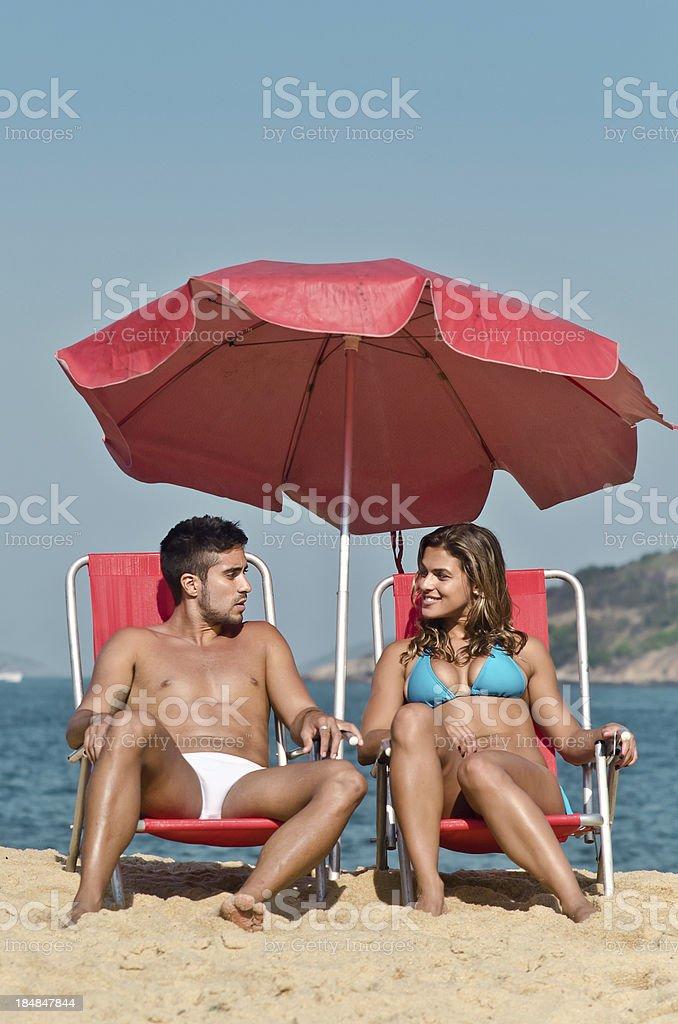 Couple on a Rio de Janeiro beach stock photo