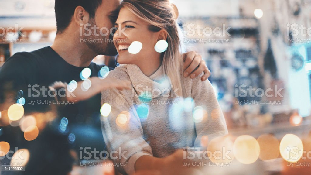 Couple on a romantic date at a coffee house. stock photo