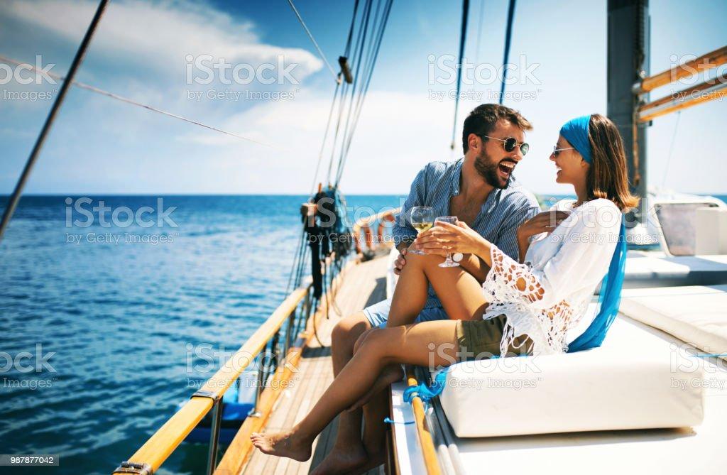 Couple on a sailboat. stock photo