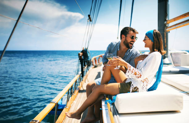 couple on a sailboat. - enjoying wealthy life imagens e fotografias de stock