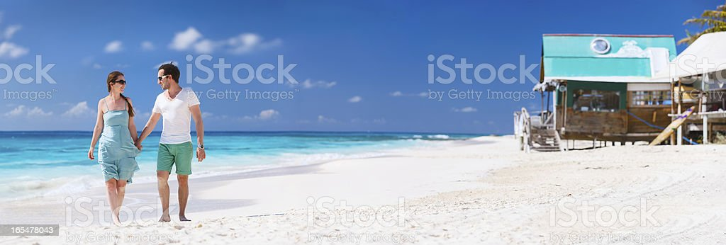 Couple on a tropical beach royalty-free stock photo
