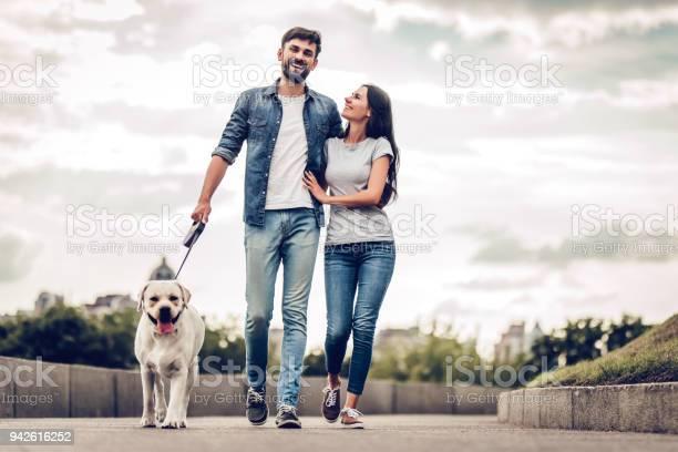 Couple on a walk with dog picture id942616252?b=1&k=6&m=942616252&s=612x612&h=jvvvn pe5 cizar4x cojmmzchhubsl2dvqzvrm7l0a=