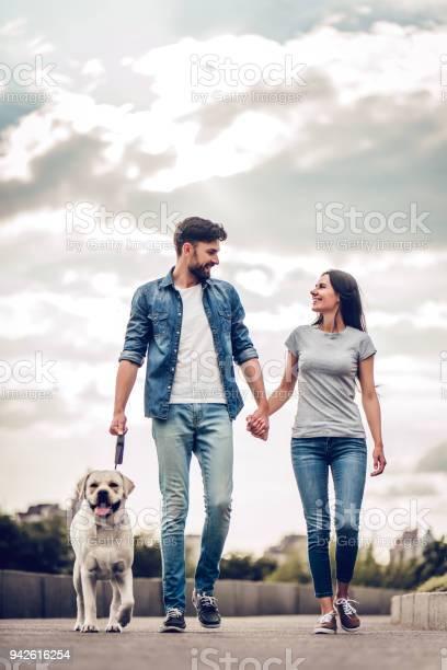 Couple on a walk with dog picture id942616254?b=1&k=6&m=942616254&s=612x612&h=xrvmfoxpdov egb50vmvtwfzo5 vvxumfaidrakwzjw=