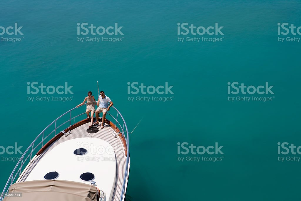Couple on a yacht in the sea stock photo