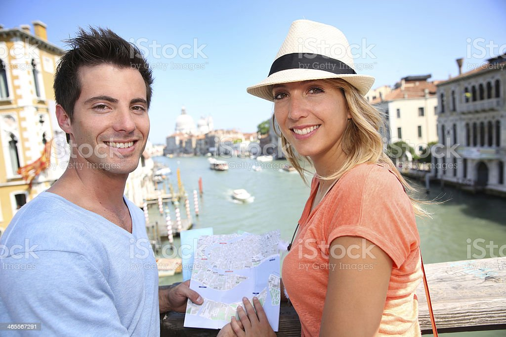 Couple on Academia Bridge looking at camera royalty-free stock photo