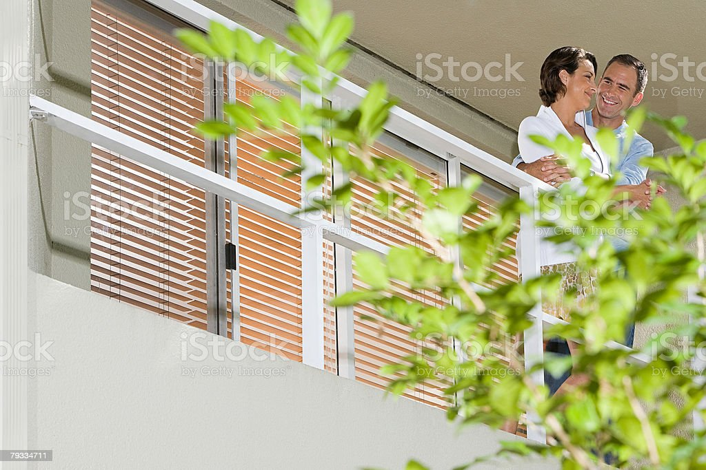 Couple on balcony 免版稅 stock photo