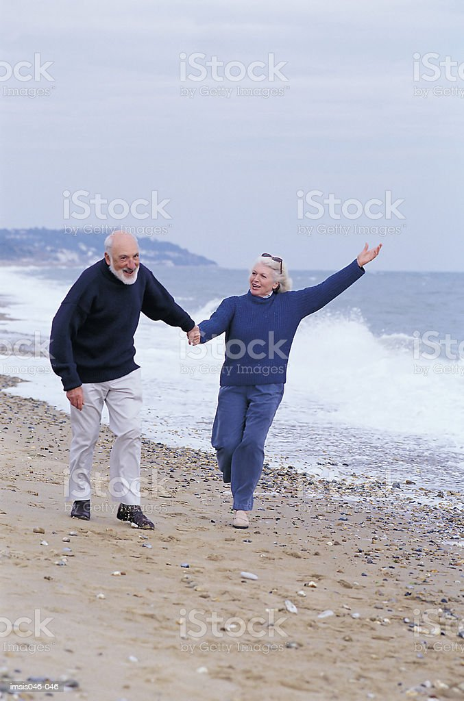 Couple on beach 免版稅 stock photo