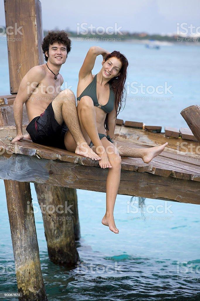 Couple on Beach Pier royalty-free stock photo