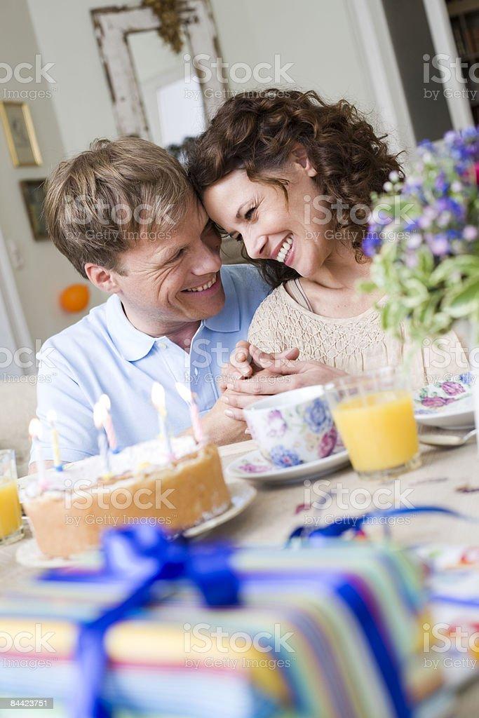 Couple on birthday breakfast table royalty-free stock photo