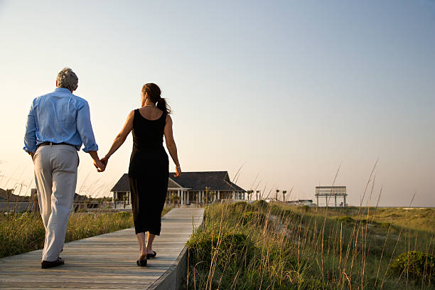 Couple on Boardwalk stock photo
