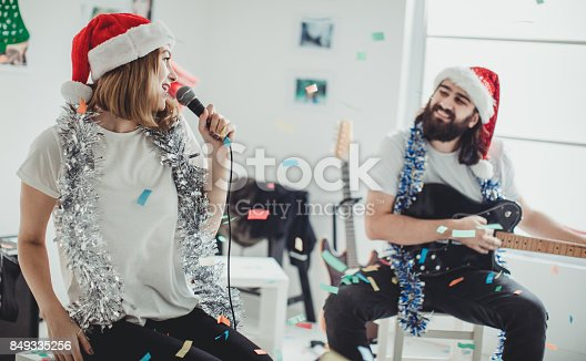 849362192 istock photo Couple on christmas day 849335256